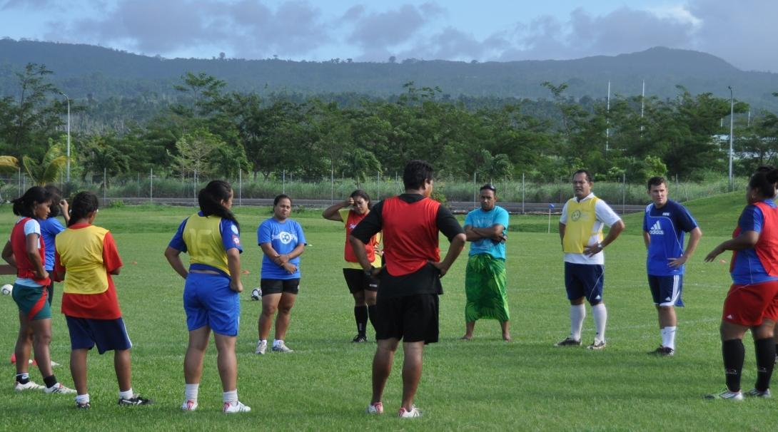 Projects Abroad volunteers coaching sport in Samoa help prepare children to participate in a football match.